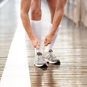 Running shoes - man tying shoe laces closeup of