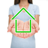 Green house eco friendly solar home woman showing open hands. Greenhouse gas environment real estate concept