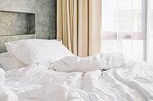 wrinkle white messy blanket on bed in bedroom in morning