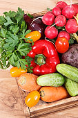 Healthy vegetables in wooden box. Source vitamins and minerals