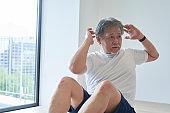 Senior man training in the room