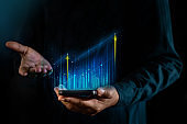 Technology, High Profit, Stock Market, Business Growth, Strategy Planing concept. a Man Presenting Graphs and Charts information on Smartphone