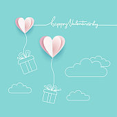Symbol of love on turquoise blue background, greeting card, paper cut design with line art style with Happy Valentine's day lettering. Hearts with gift boxes. vector illustration with space for text