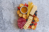 Assortment of cheese, salami and other appetizers