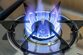 Blue flame on a gas whip, close-up, of the side view