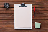 Clipboard with Blank Paper on a Wooden Background