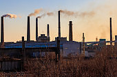 View of old factory with pipes with smoke. Air pollution, environmental damage