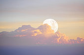 White moon in the blue sky before sunset, The moon rose at Early Evening, Beautiful nature background.
