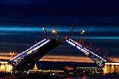 Opening of Palace drawbridge. Night view of Palace bridge from the Neva river in Saint Petersburg, Russia