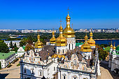 View of Dormition Cathedral of the Kyiv Pechersk Lavra (Kiev Monastery of the Caves) and the Dnieper river in Ukraine. View from Great Lavra Bell Tower
