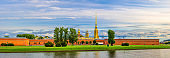 Panorama of Peter and Paul Fortress, Saints Peter and Paul Cathedral Orthodox church gold spire, fortress walls on Zayachy Hare Island, Kronverksky Strait channel, Saint Petersburg city, Russia