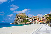 Watercolor drawing of seaside town village Scilla with old medieval castle on rock Castello Ruffo, colorful traditional typical italian houses on Mediterranean Tyrrhenian sea coast, Calabria, Italy