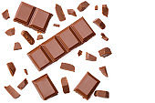 Milk chocolate pieces isolated on white background. top view