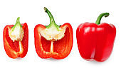 red sweet bell pepper with slices isolated on white background. top view