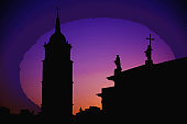 Watercolor drawing of Silhouette of Bell Tower and monuments on roof of Cathedral Basilica Of St. Stanislaus and St. Vladislav on Cathedral Square, colourful evening sky at sunset, Vilnius, Lithuania