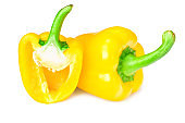 yellow sweet bell peppers with slices isolated on white background