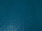 Sea surface aerial view, top down landscape of ocean water.