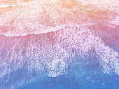 Summer sea surface aerial view from above, beautiful ocean wave.