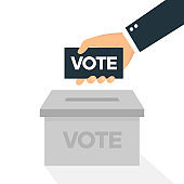 Voting icon in flat style hand putting vote paper in the box