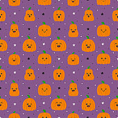 happy halloween pumpkins with different faces seamless pattern isolated on purple background. vector illustration.