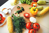 Seasonal vegetables on a bright kitchen table.