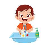 happy cute little kid boy wash hand in sink