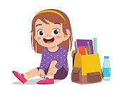 happy cute little kid girl tie shoe shoelace