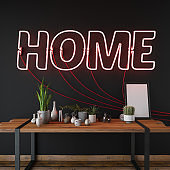 Neon Home Sign Against Black Wall with Table and Decors
