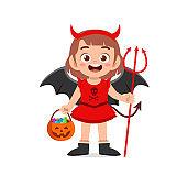 happy cute little kid boy and girl celebrate halloween wears red devil monster costume