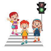 happy cute little kid boy and girl cross the road