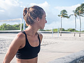 Sportive young woman jogging outdoors on beach, Miami Beach