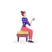 Girl sitting in chair and drinking coffee or tea at home.