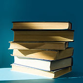 stack of old books, on a blue background