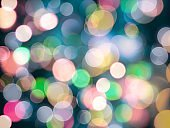 round blurred lights abstract background in glowing pastel neon vibrant colors