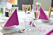 Romantic festive wedding table set in pink color