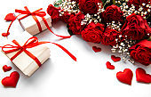 Valentine gift box and red roses bouquet