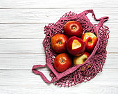 Mesh shopping bag with apples