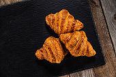 Croissant on black stone plate
