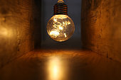 Light bulb lamps with warm light over old wooden background