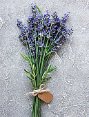 Overhead view of a bundle of fresh lavender flowers with blank tag