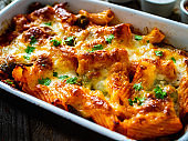 Pasta casserole with barbecue chicken breast, cheese and vegetables