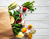 Healthy food background. Healthy  food in paper bag, vegetables and fruits.