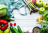 Fresh vegetables and fruits with a string bag