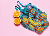 Mesh shopping bag with fruits