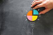 Education concept image. Creative idea and innovation. Tangram as light bulb metaphor over blackboard