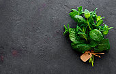 Fresh mint leaves herb on stone table. Top view