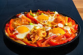 Shakshuka - fried eggs with smoked salmon vegetables