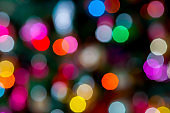 Festive colorful abstract background with bokeh lights.