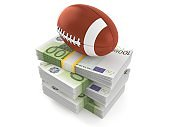 Rugby ball on stack of money
