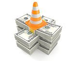 Traffic cone on stack of money